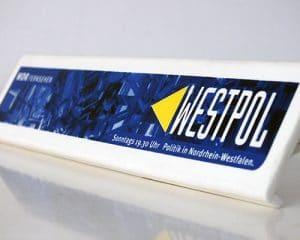 Im Siebdruckverfahren bedruckte Kunststoffklammer für Blocks